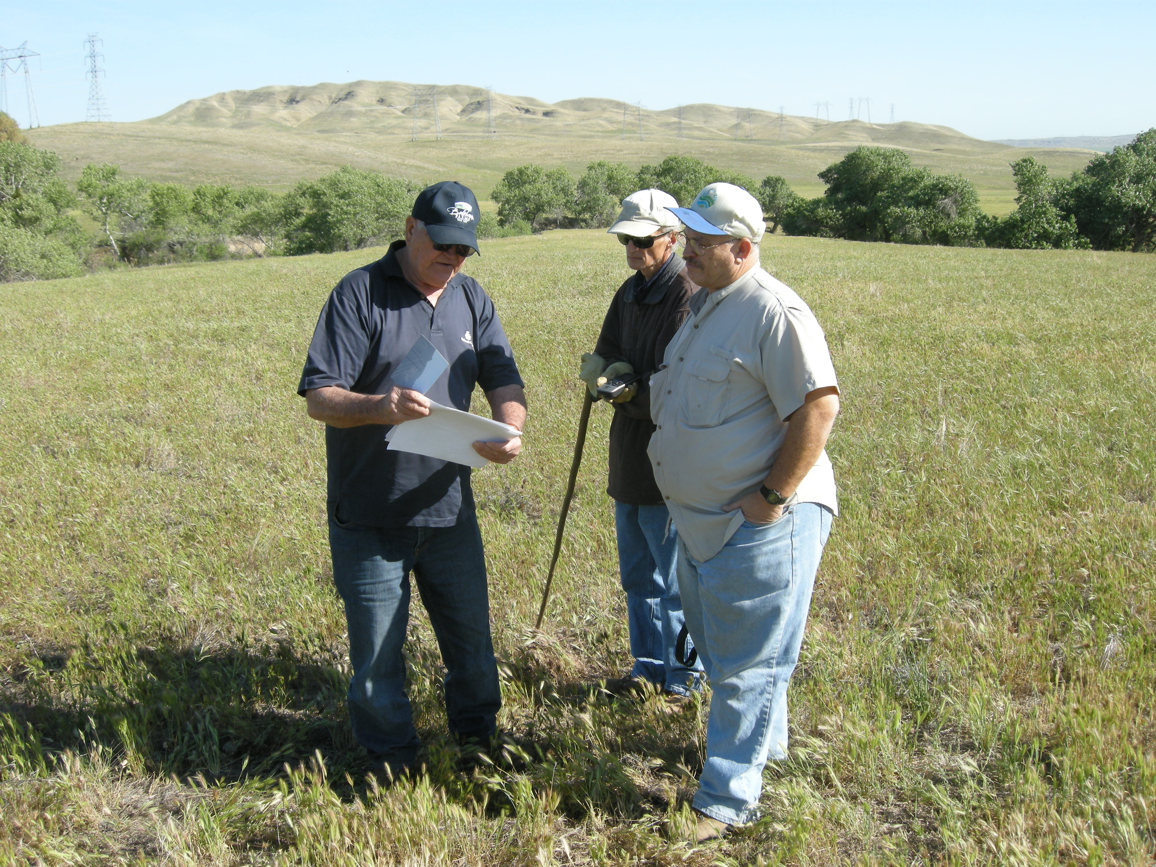 men out in a field in California