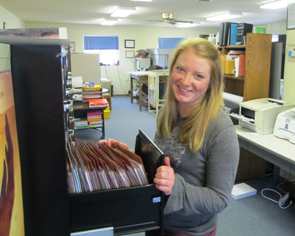 Volunteer working in office filing