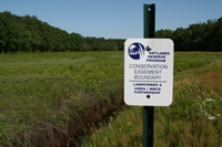 A sign marks the boundary of the WRP easement.