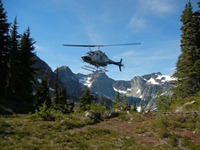 Snow survey team arrives by helicopter to repair site
