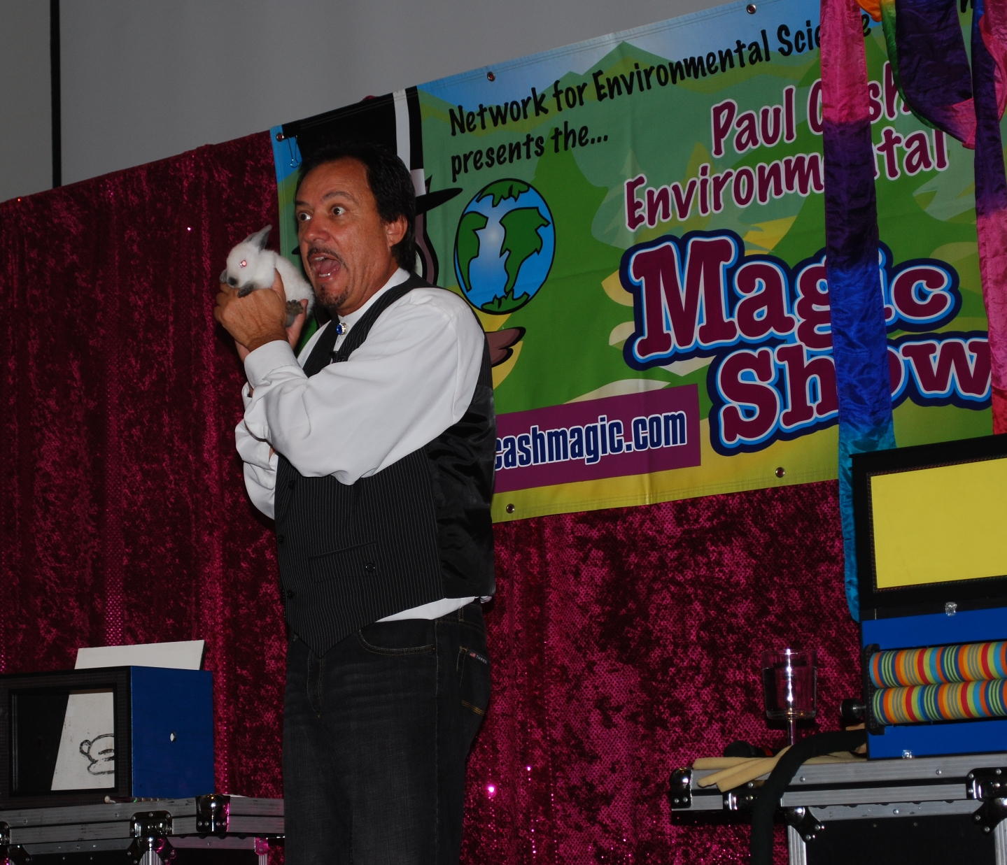 Magician on school stage