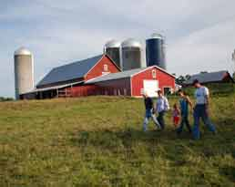 A family who works with NRCS walks their fields