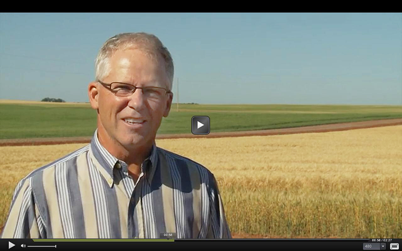 North Dakota farmer Mike Zook compares healthy, living soil to fallow, dead soil.