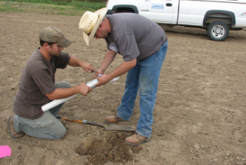 "Biological Technician, Nick Adams (left) and Soil Conservationist, Allen Casey (right), collecting soil bulk density samples for the ""Effect of Mixed Species Cover Crops on Soil Health"" study."