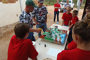 Station Two – Wade Day, assisted by Jacob Maenius, NRCS, show students a watershed model of Fort Chadbourne.