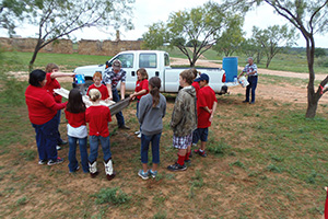 Station Three – James Jackson, Texas Agri-Life Extension, teaches students how they can harvest rain water from roofs of buildings.