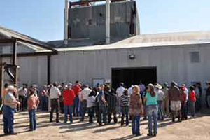 Farm Tour participants gather outside the Landmark Earth Solutions plant to tour the facility, as well as hear what products are locally made.