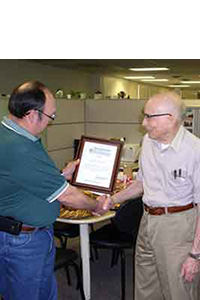 Salvador Salinas, Texas State Conservationist, presents Chuck with a 20 year Earth Team Volunteer recognition award.