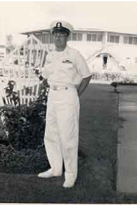 Nineteen-year-old Charles (Chuck) Damron, RMC U.S. Navy 1962, in front of his barracks in the Philippines.
