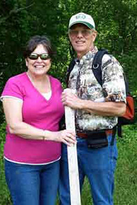 Jim Reed and his wife, Judy, are shown enjoying a hike on the Reed Family Ranch.