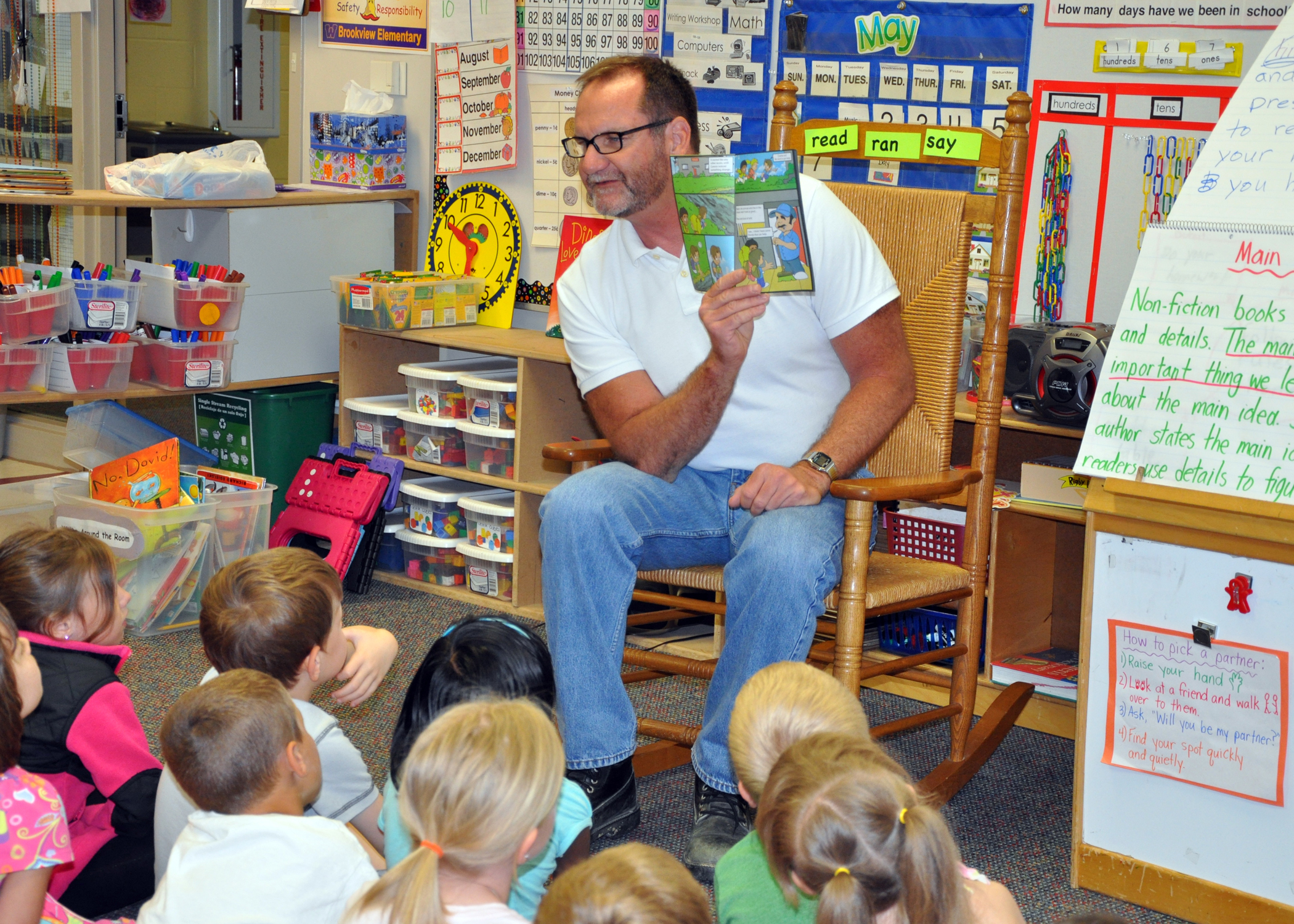 Dallas County District Conservation Brad Harrison reads WhoBuddies to Waukee kindergartners.