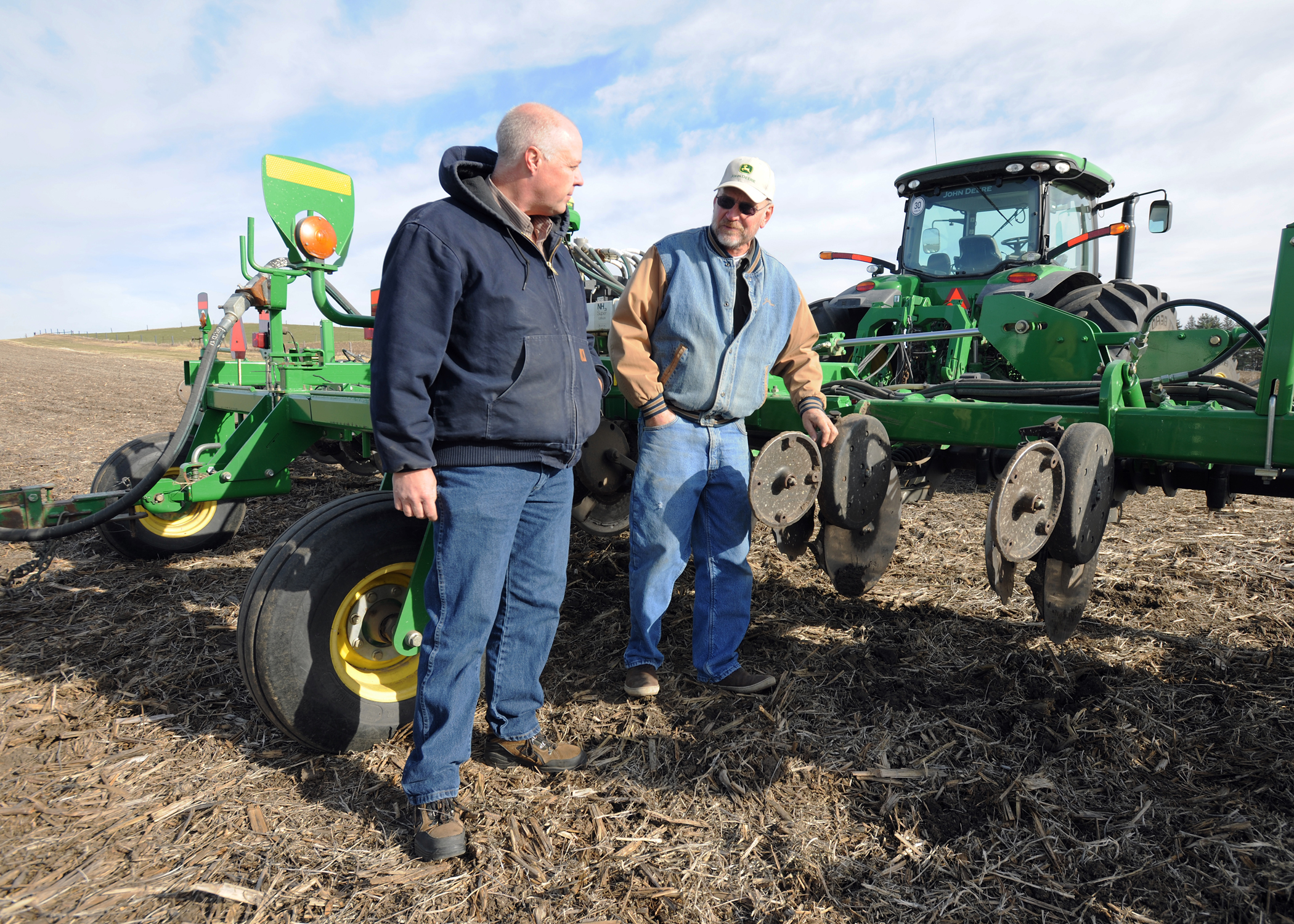 Tama County farmer Wade Mitchell shows District Conservationit Larry Jones his nitrogen applicator.
