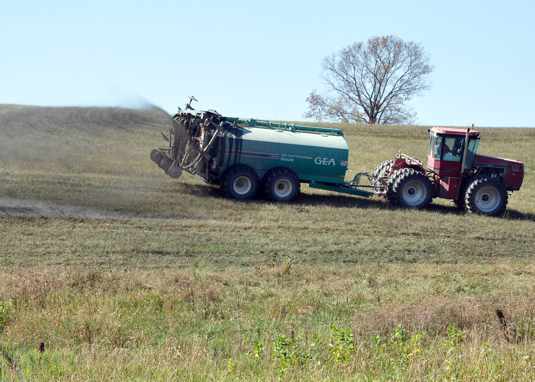 A southwest Iowa farmer spreads manure on pasture.