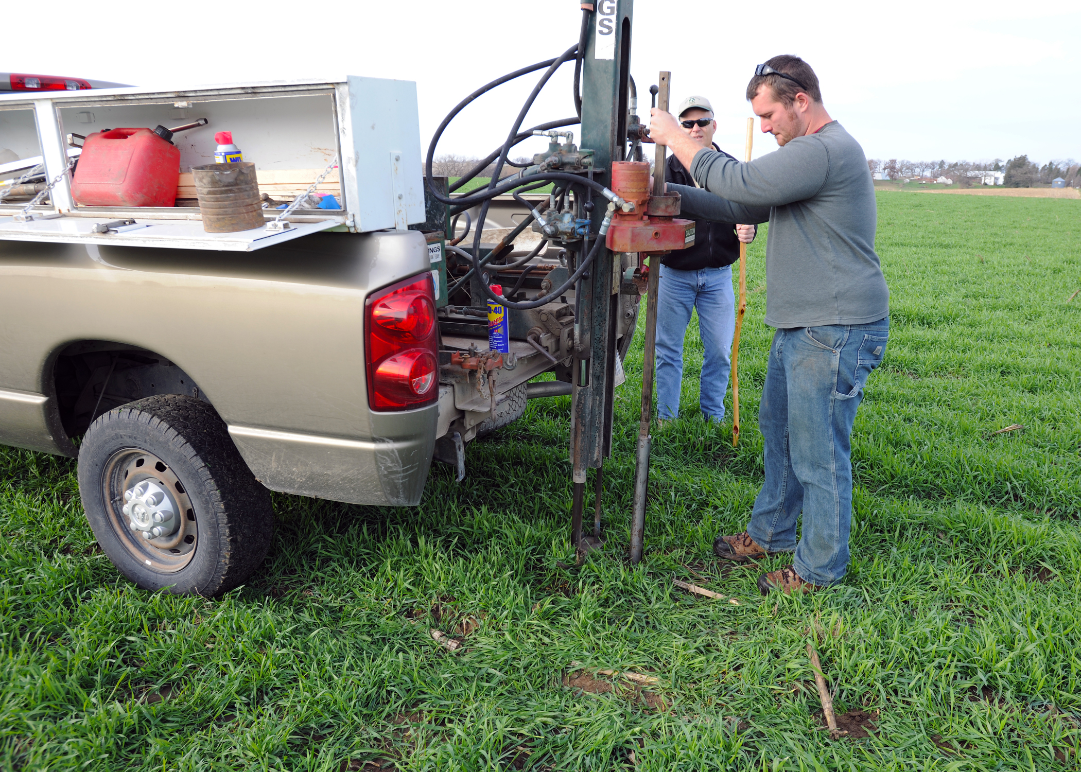 Soil Scientist Patrick Chase takes soil from a field of cover crops during fall 2012.
