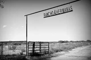 The entrance to Javier Mancha's ranch showcases his love and family pride for his four daughters.
