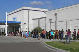 A line forms early as participants eagerly await the doors to open to the Eagle Pass Annual Back to School Health Fair.