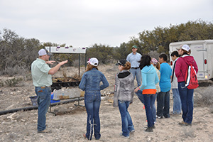 NRCS employee, Kendall Tidwell (left) explains the harm of soil/wind erosion.