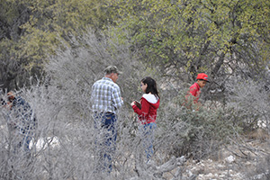 Texas AgriLife Extension employee, Nick Garza (left) identifies native plants.