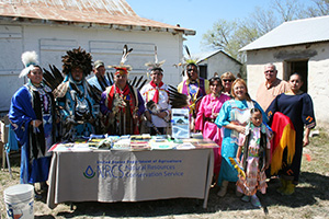 Members of the American Indians of Texas Dance Theatre of San Antonio visit the NRCS booth.