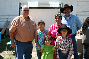NRCS DC, Fernando Garza with Lopez family who feel NRCS' assistance has helped them survive drought.