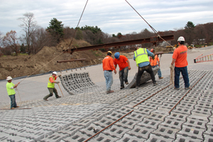 Workers armor the George H. Nichols Dam in Westborough