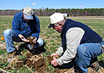 Chris Lawrence and Jim Tate, HCSWCD, examine soil in a local field.