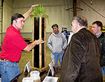 J.B. Daniel demonstrates soil health concepts with a root box.