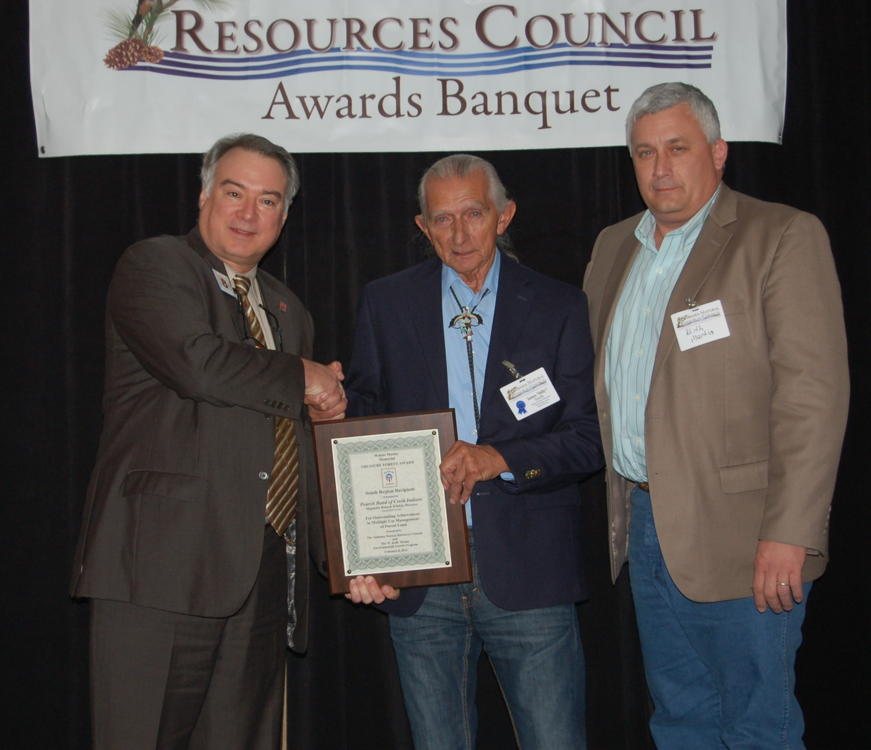 (l-r) Dr. James Shepard presents Helene Mosley TREASURE Forest Award for the South Region to Billy Smith and Keith Martin of the Poarch Band of Creek Indians.