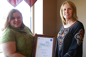 Ramona, Taylor (right) recognizes Cecilie Lane (left) for her contributions to conservation.