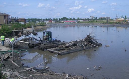 Buggy and barge being used to remove debris from Forest Lake.