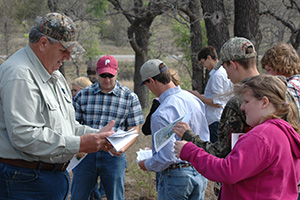NRCS Wildlife Biologist Ricky Linex (left) helped students during the regional competition.