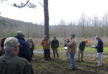 Tim Albritton discusses with attendees recommendations for a pine stand.