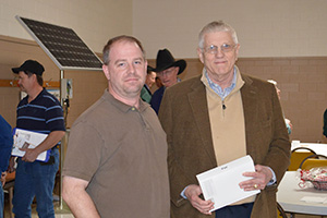 Raford Hargrove of Hargrove Insurance presents an iPad to a lucky raffle winner.