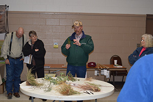 James Lewis with the NRCS explains the value of different plants for livestock and wildlife.
