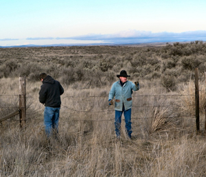 Rancher Kay Leander and his son Joel repair a fence on their ranch to protect Sage Grouse on his land.