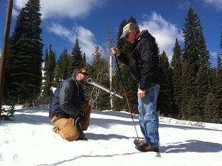 Ron Abramovich, NRCS Water Supply Specialist measures Mores Creek Summit snow course near Idaho City