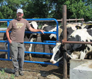Jerry Butler of Cedar Hill Farm stands with his heifers