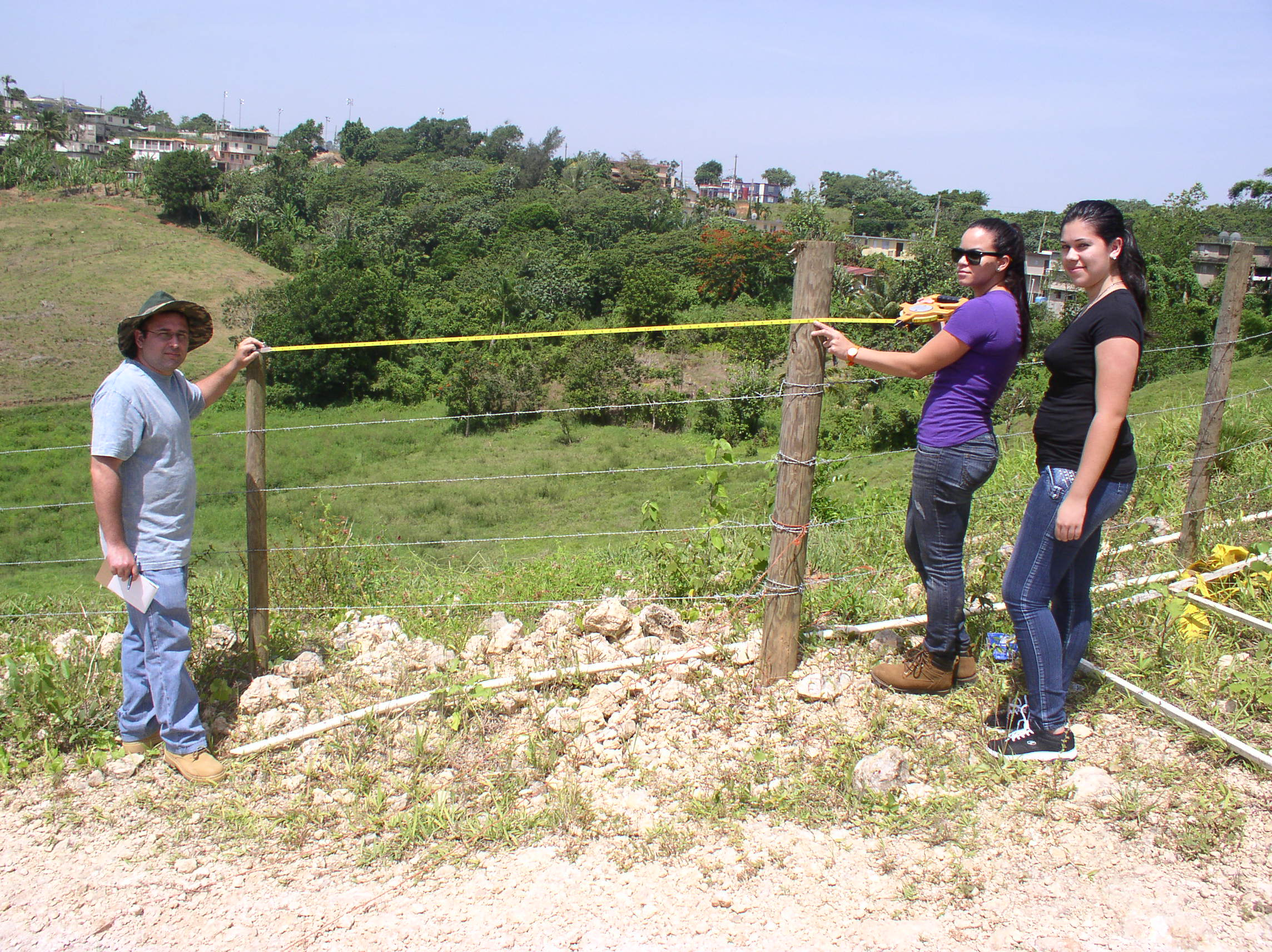 Utuado Field Office volunteers, Eliud Torres Vaquez (Earth Team [ET]), Erica M Claudio Rivera (Ag. student/ ET), and Gudianne Romero Mendez (Ag student/ ET) assist with pasture field fencing construction.