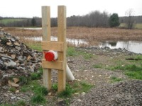 A dry hydrant installed within a wetland for fire protection