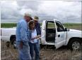 NRCS District Conservationist discussing a conservation plan with a landowner