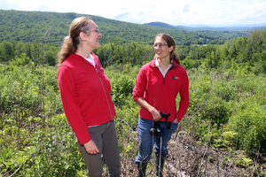 Hazel Holman (left) and NRCS District Conservationist Kate Parsons in the area that was clear-cut for early successional wildlife habitat.