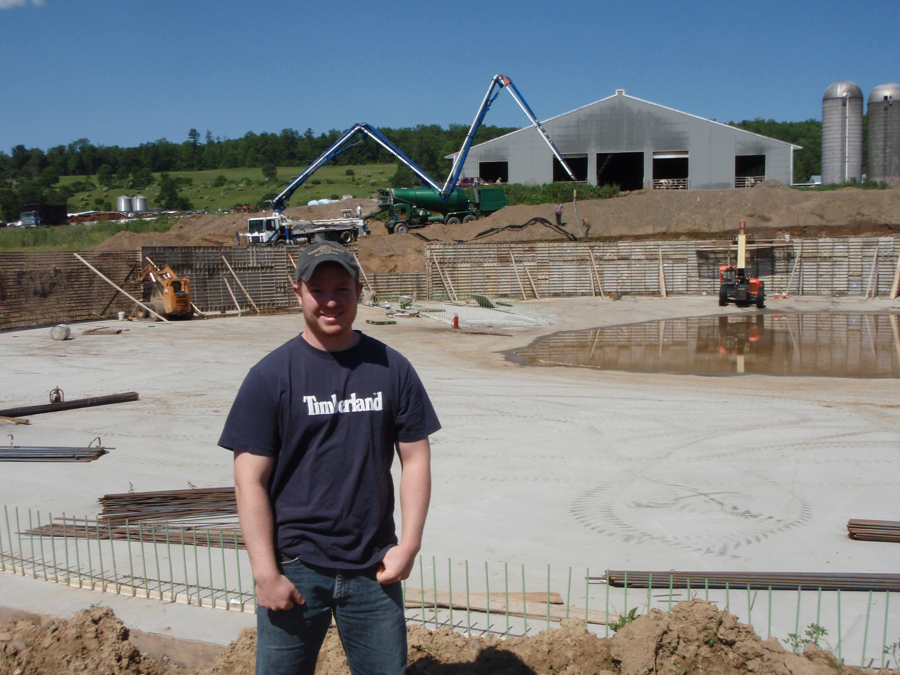 Earth Team Volunteer Derek Walling at a construction site of a waste storage facility. Click image for full screen view
