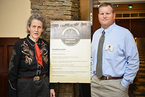 Temple Grandin with conference organizer Jeff Goodwin, NRCS grazing specialist.