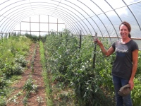 Pam Schreiber with a new high tunnel that extends her vegetable crops growing season