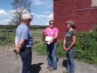 Pam Schreiber, farm owner and operator, with CNMP planner Sally Flis, and NRCS District Conservationist, Eric Swanson
