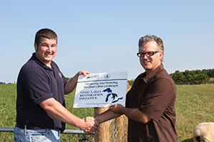 farmer receives GLRI sign
