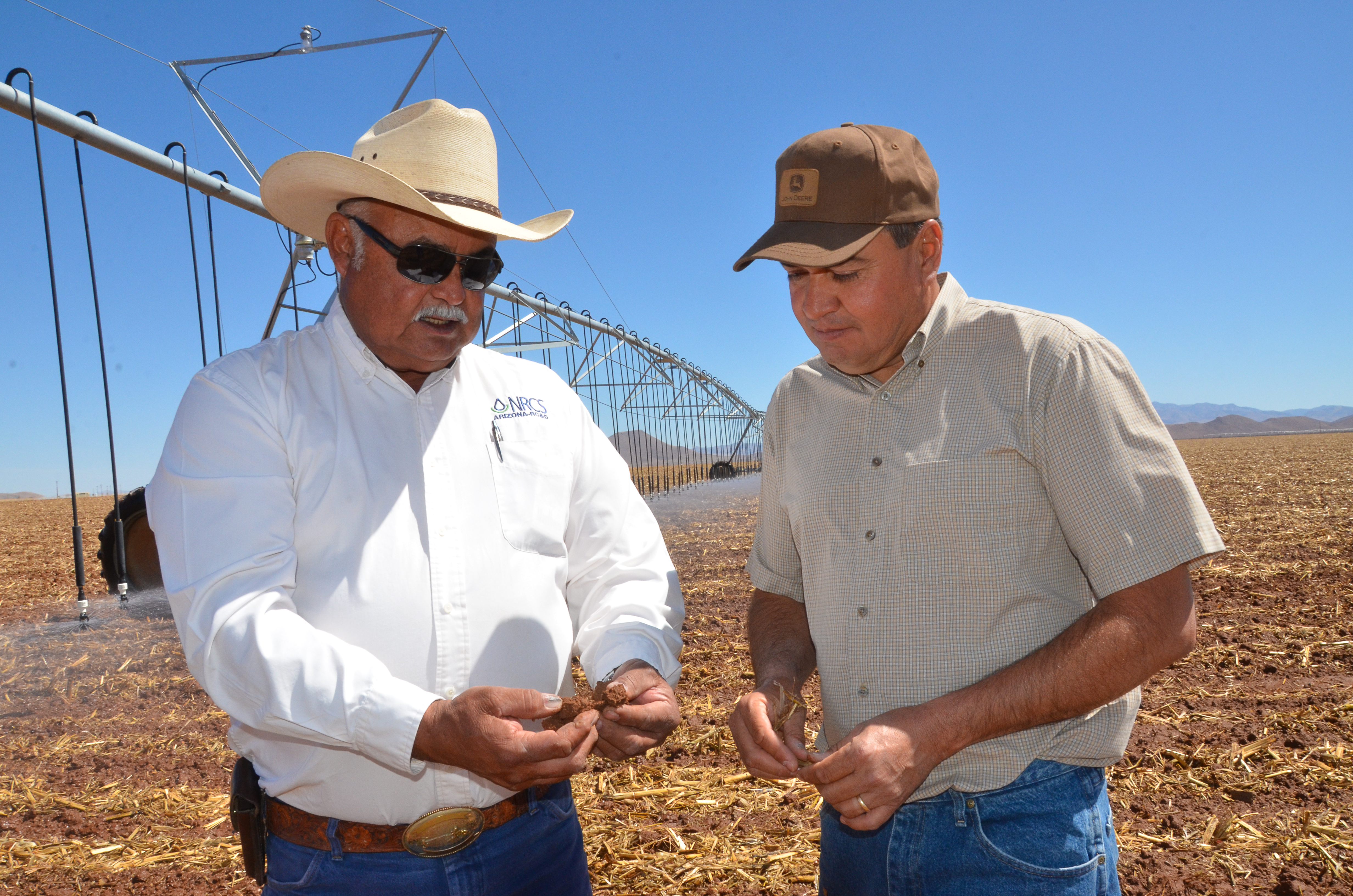 Alfredo Zamora (right) worked with NRCS District Conservationist Gerry Gonzalez to install pivot irr
