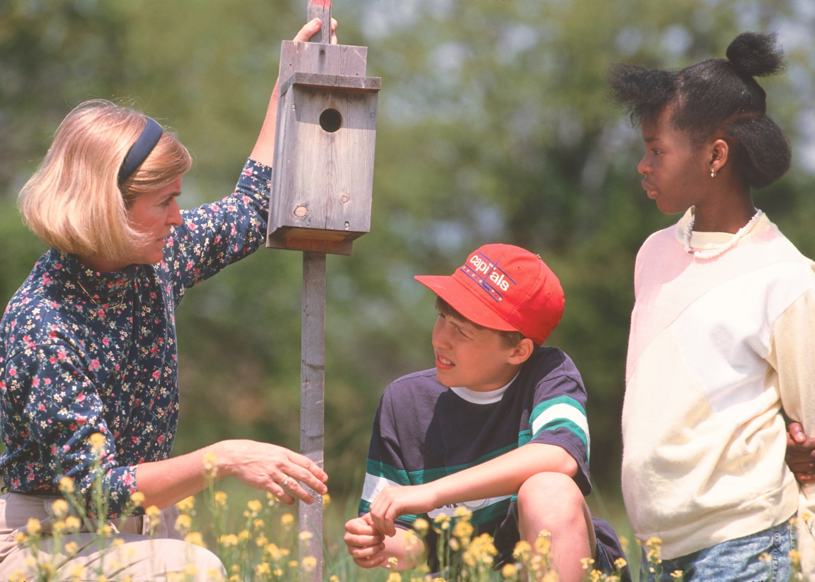 Conservation Education - Teacher with students and duck nesting box