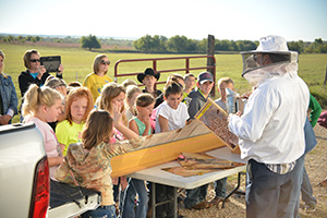 A local bee keeper taught students how important bees are to pollinating crops in the field.