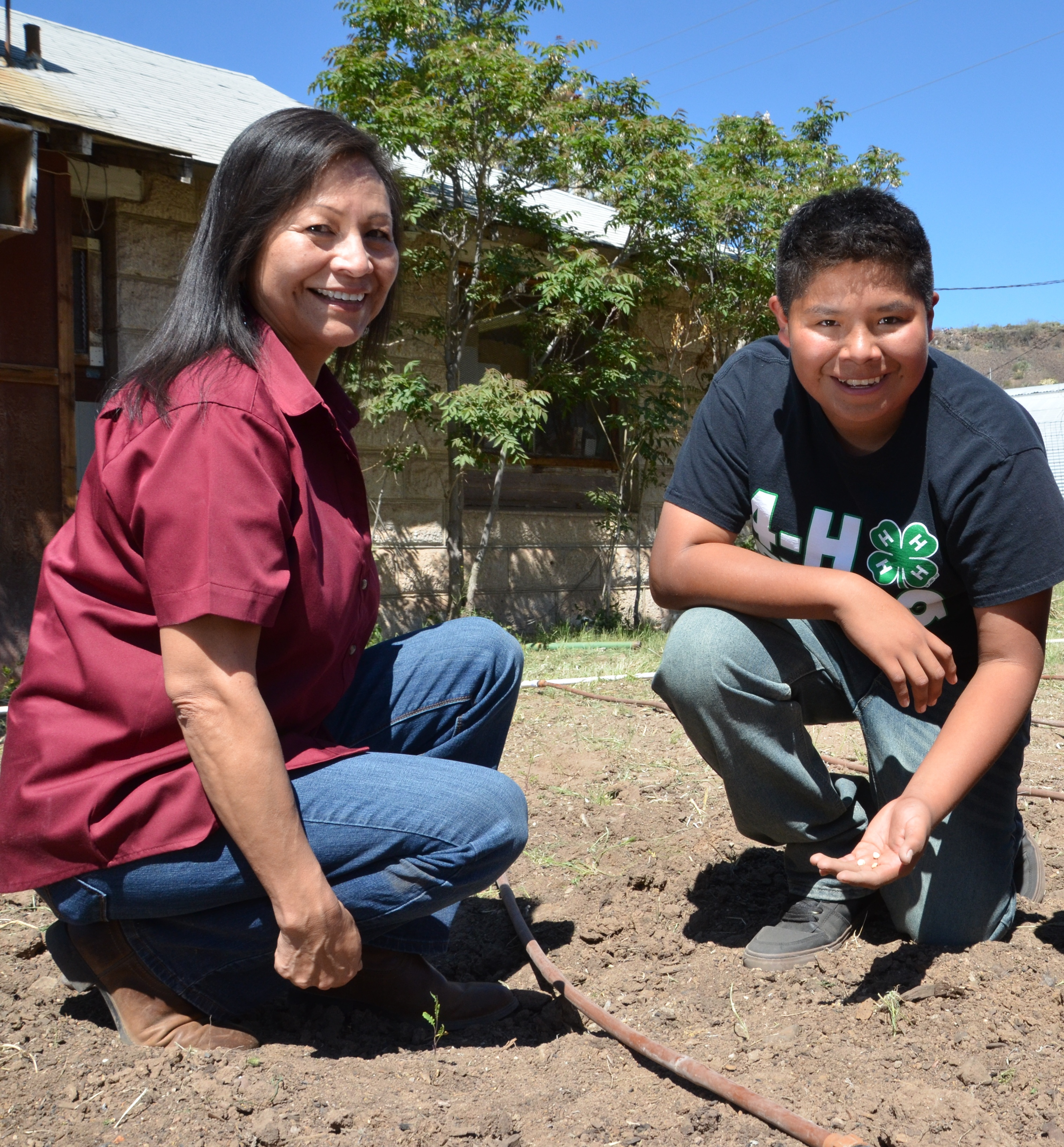 Millie Titla, NRCS district conservationist in San Carlos, Ariz., and Noah Titla, San Carlos 4-H Gar